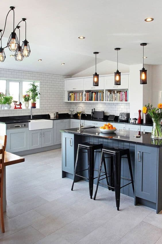 granite countertop with blue cabinets and open shelving in white interiors