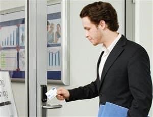 Assa Abloy Access Control - Global-Solutions-Technology Platforms-Aperio_escutcheon_iclass card_office_man