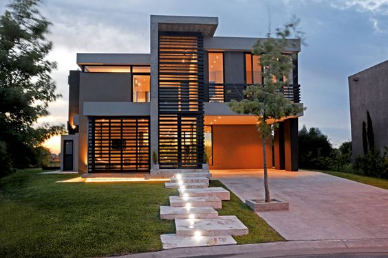 front elevation designs for 2 floors building with proper lighting, lawn and walkway