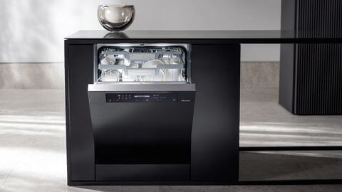"""Miele dishwasher placed securely under the kitchen platform design"