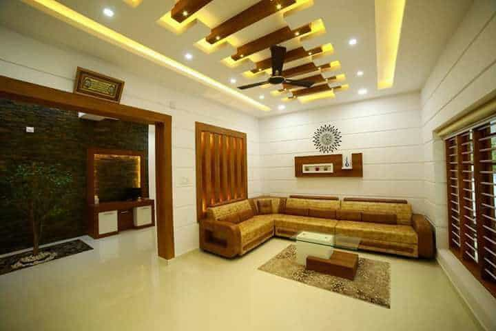 White and brown false ceiling with lights.