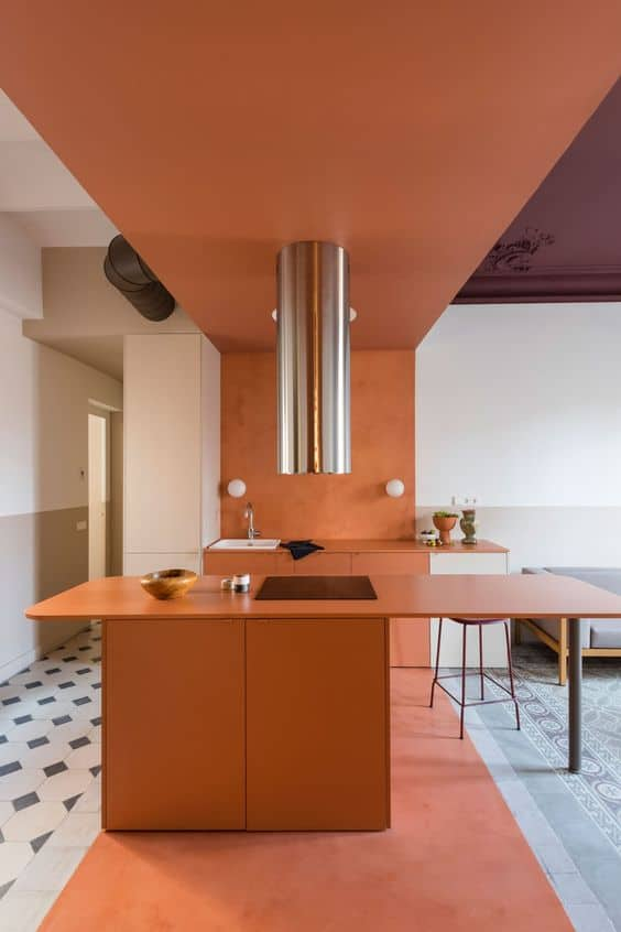 orange countertop with overhead pendant light with orange ceiling