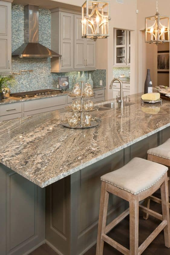 grey textured granite countertop designs for kitchen with light coloured interiors