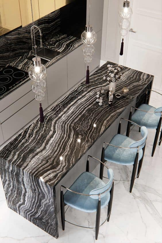 white waves on a black granite surface with white floors