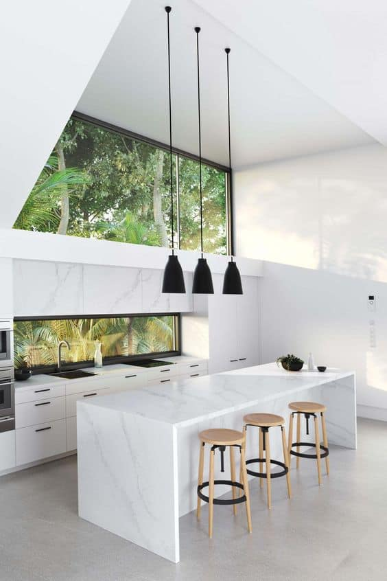 smooth marble surface with high walls and black pendant lights