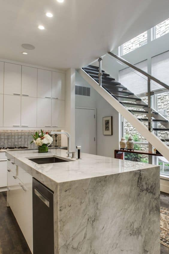 textured quartzite countertop for an open kitchen with adjacent staircase