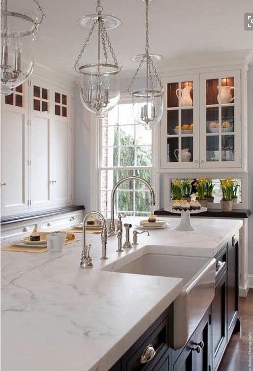 white quartzite countertop for a white spacious kitchen