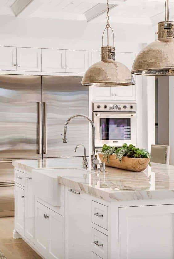 quartzite countertop for kitchen with huge refrigerator and pendant lights