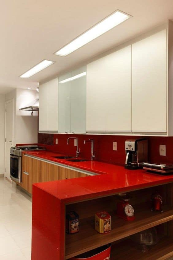 red countertop designs with white cabinets and ceilings.