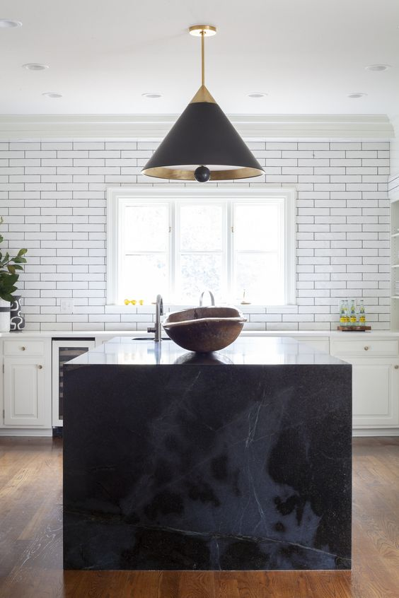 pure black countertop for kitchen with an overhead black light and white interiors