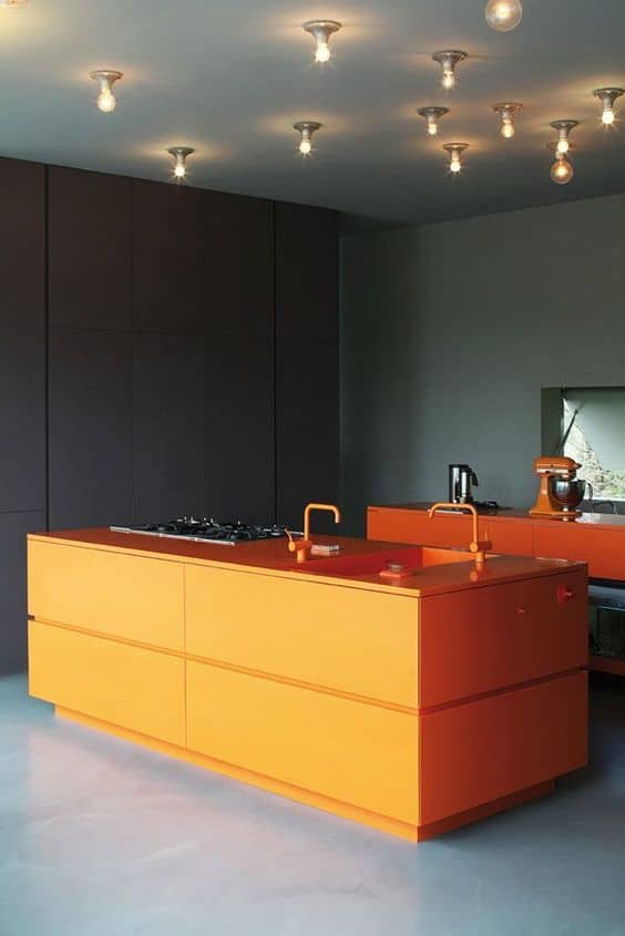 orange countertop in a black kitchen