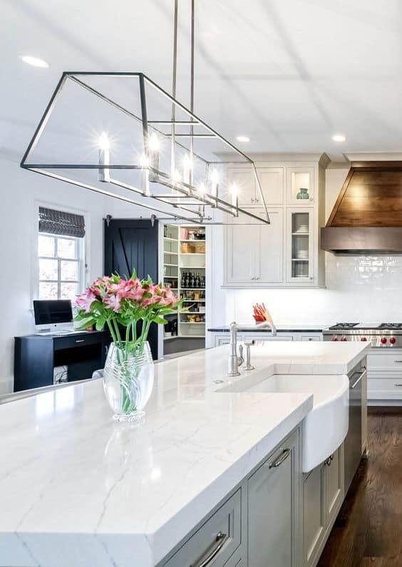 white quartz kitchen countertop designs with ceiling lights in a modular kitchen
