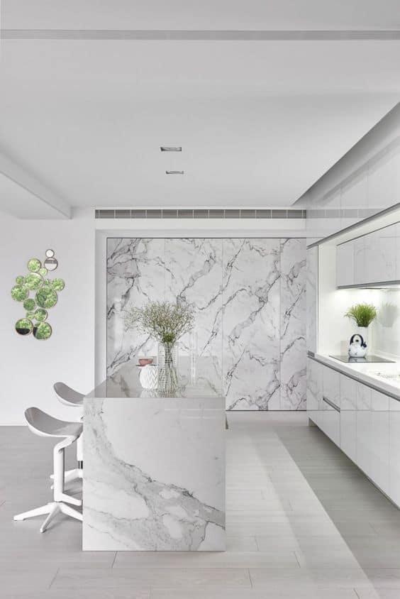 white quartzite countertop for a white kitchen