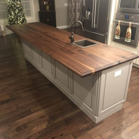 wooden countertop designs with a neutral colour base for a kitchen with wooden flooring