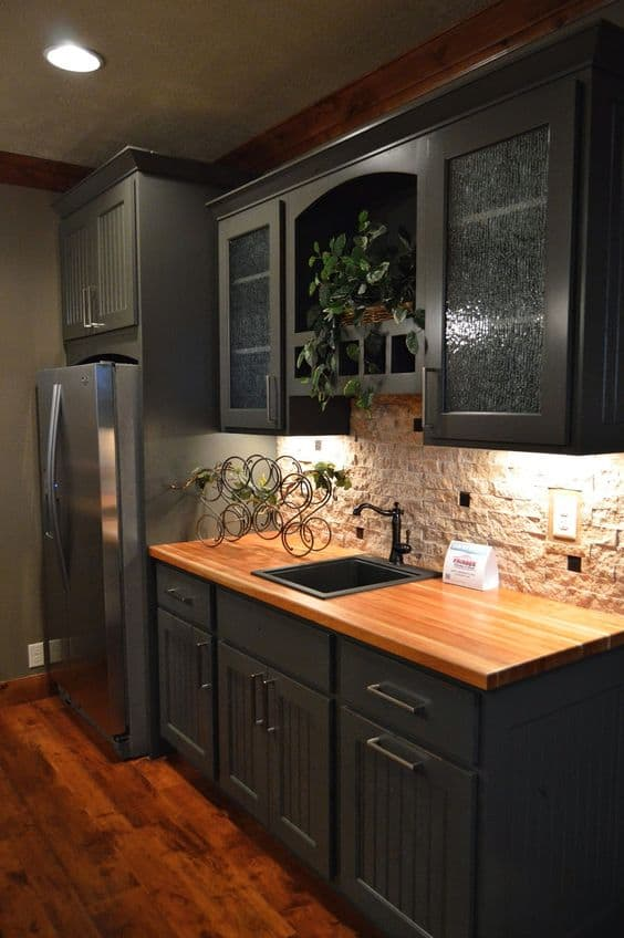 wooden countertop with black cabinets and drawers for a kitchen.