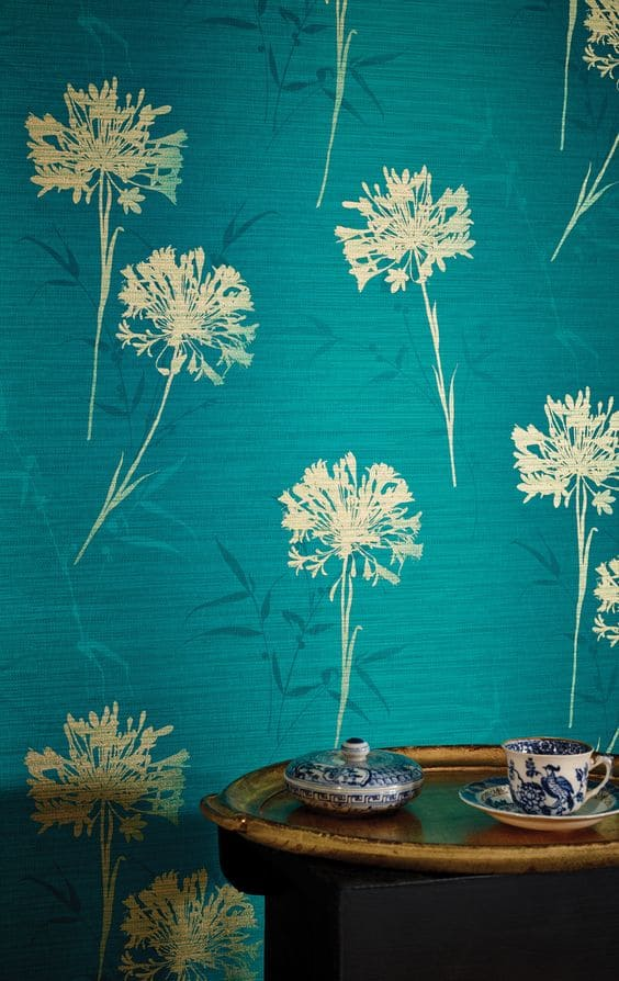 blue textured paint with golden floral stencil