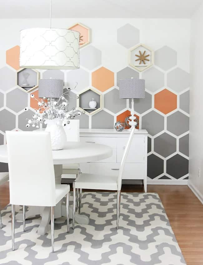 neutral wall paint design with honeycomb pattern and warm orange for a pop of color