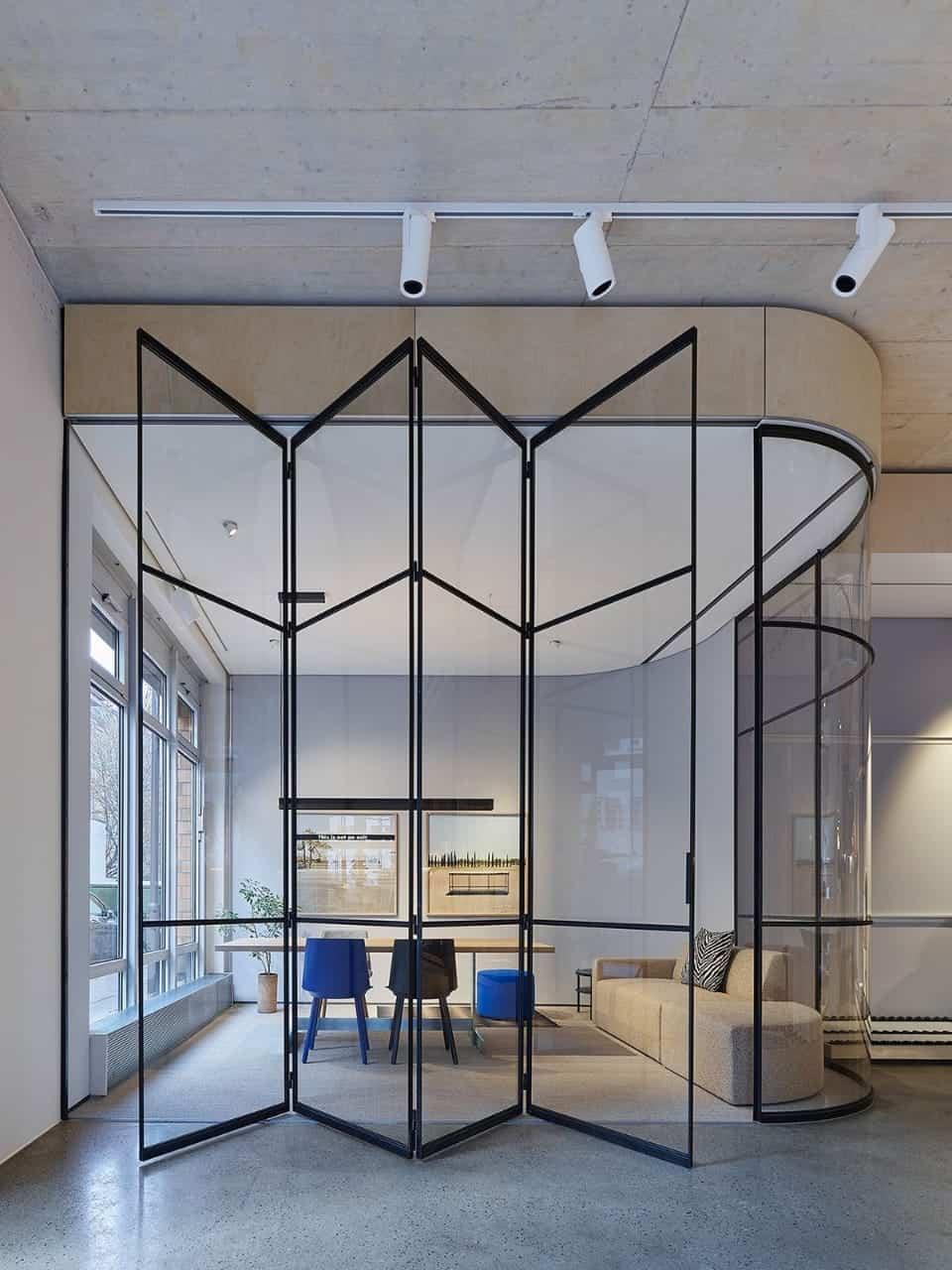 glass bi-fold living room door designs with black metal frame