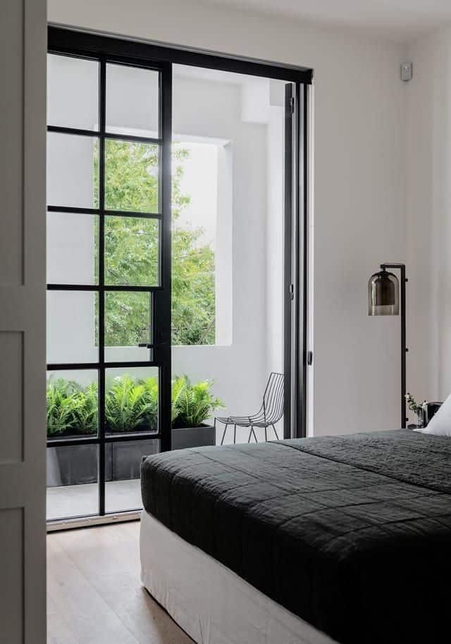sliding glass bedroom door design with black frame