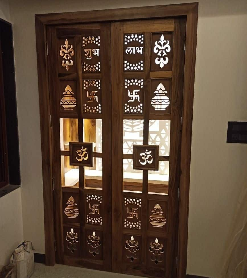 pooja room door designs with wooden frame and motifs
