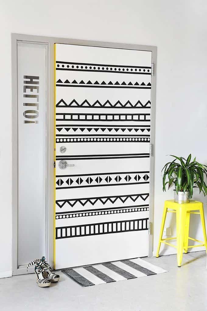 white door with black doodle paint