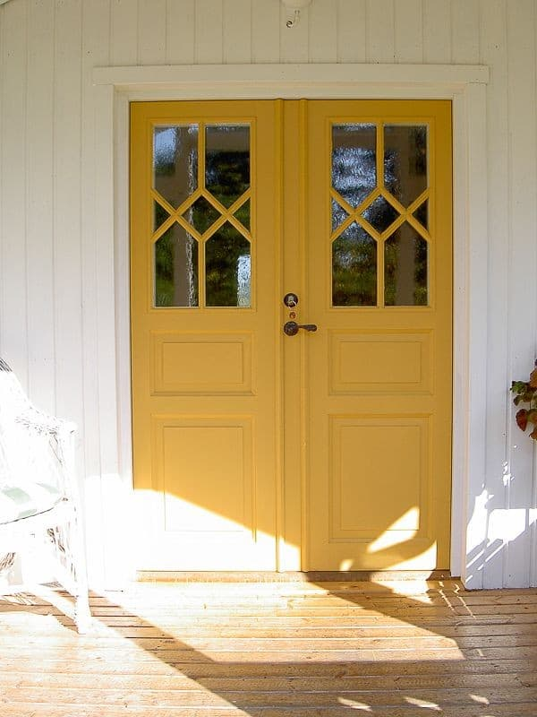yellow colored door with glass panel