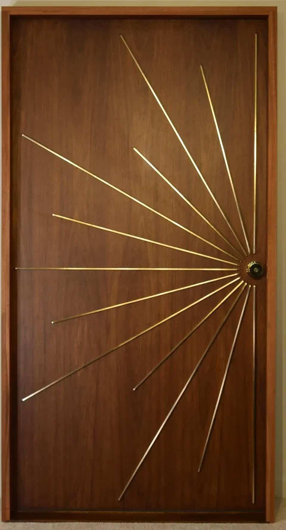 hinged wood door with golden accents