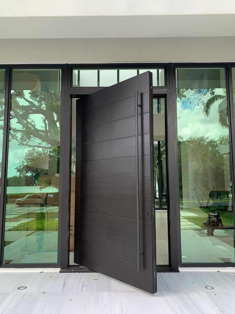 dark brown pivoting door designs