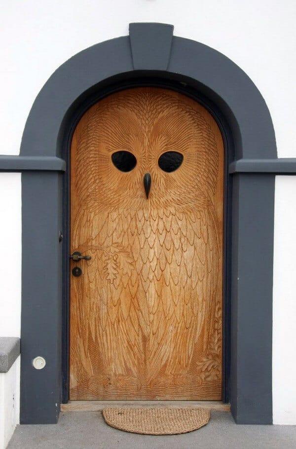 owl motif carved on a wood door