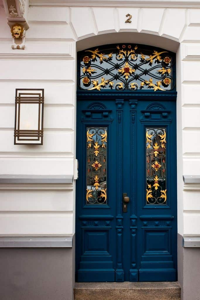 blue door with red and golden accents