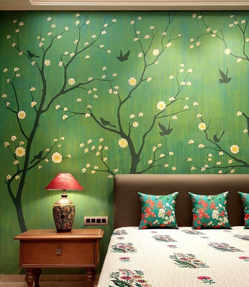 a green backsplash with nature mural