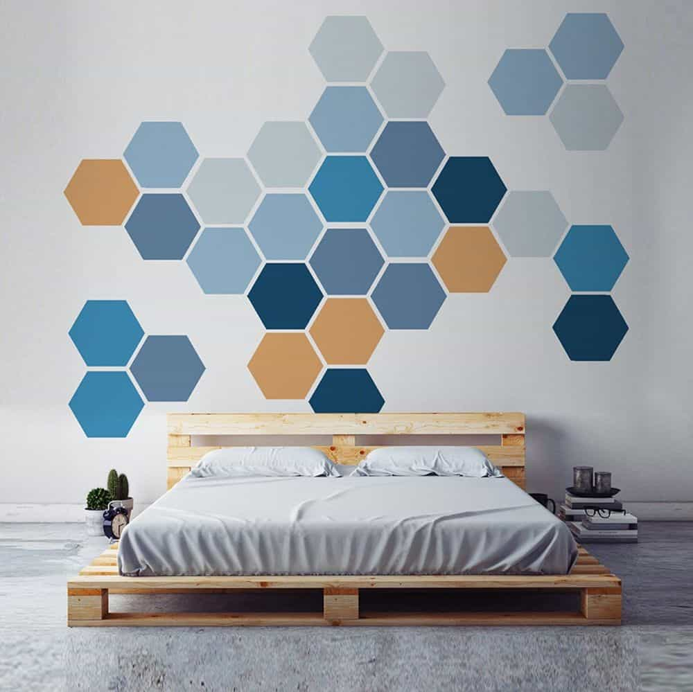 wall paint design with honeycomb pattern on a wall with shades of blue and orange