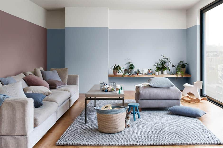 vertically divided living room wall paint design with blue and white color