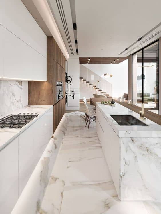 marble texture ceramic tiles for a kitchen with white counter top and cabinets.