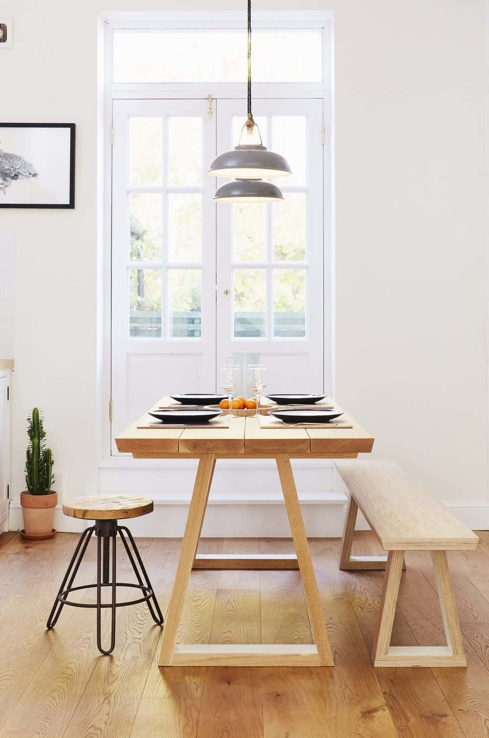 bespoke plywood table for dining in front of a white glass door