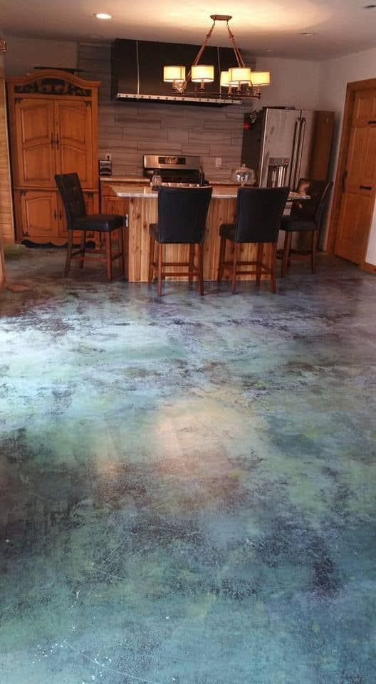green epoxy flooring for kitchen with black chairs and wooden furniture