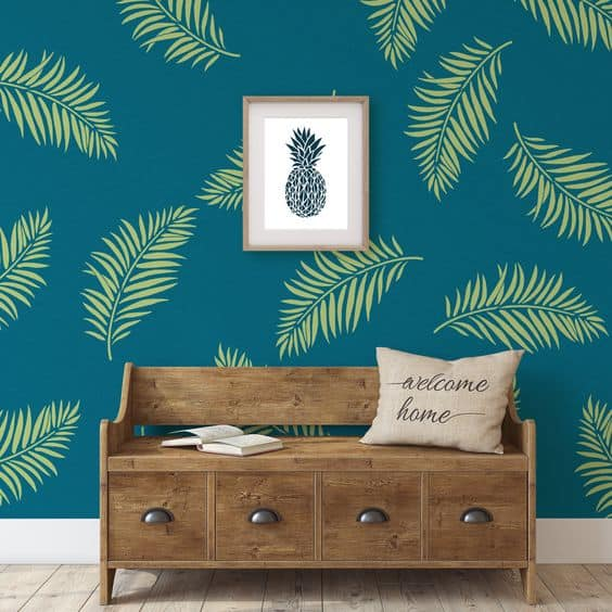 green palm leaves stenciled on a blue wall paint design