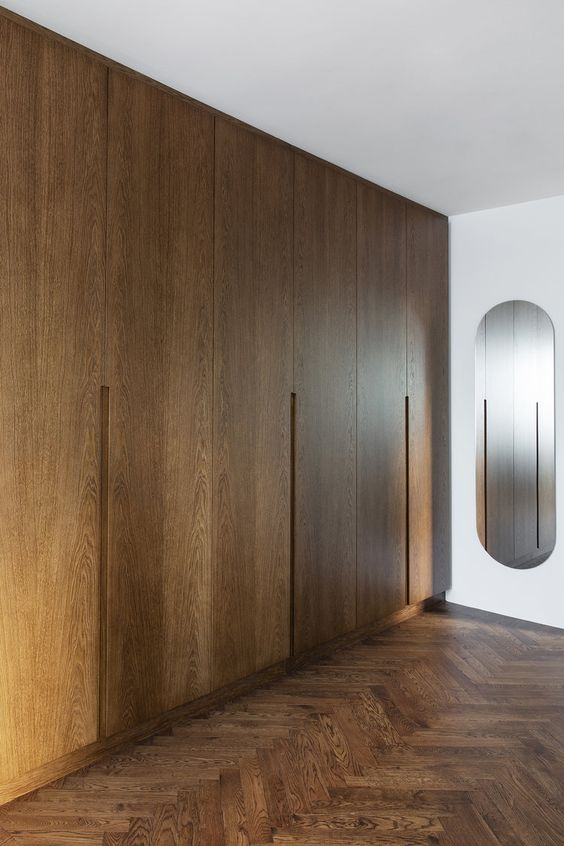 light brown multiple door wardrobes with mirror on the wall