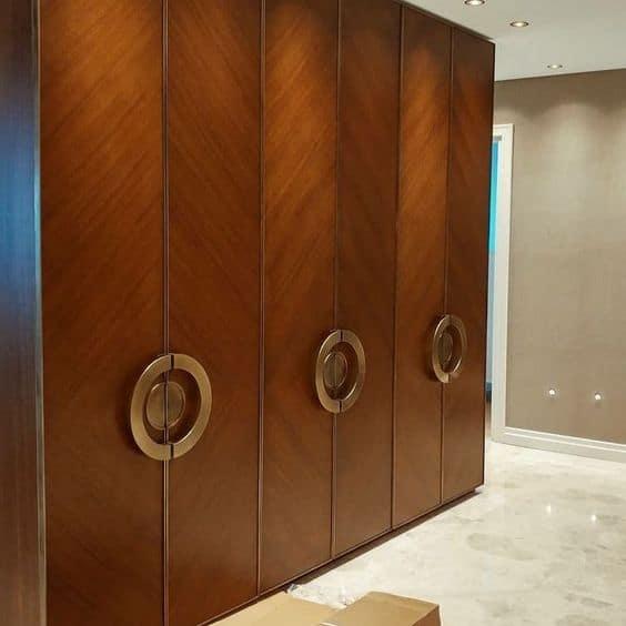 round designer closet handles for a brown closet