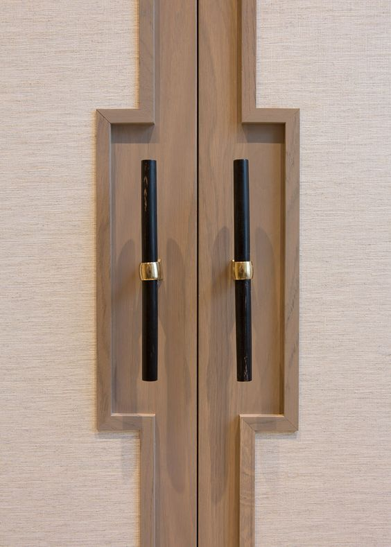 Black handles with a cream cupboard