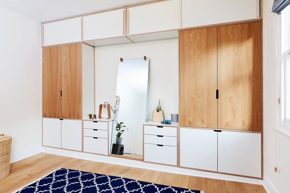 White and light brown wardrobe with a dresser and mirror