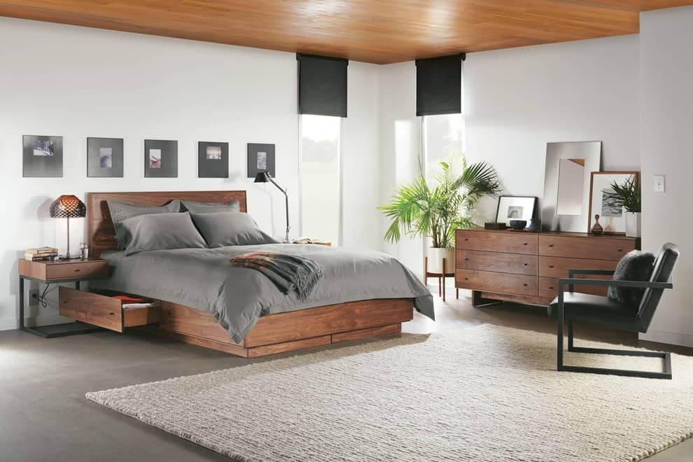 brown plywood bed with storage drawers