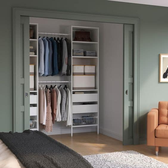 white and green walk-in closet with interior design, lights, and drawer system