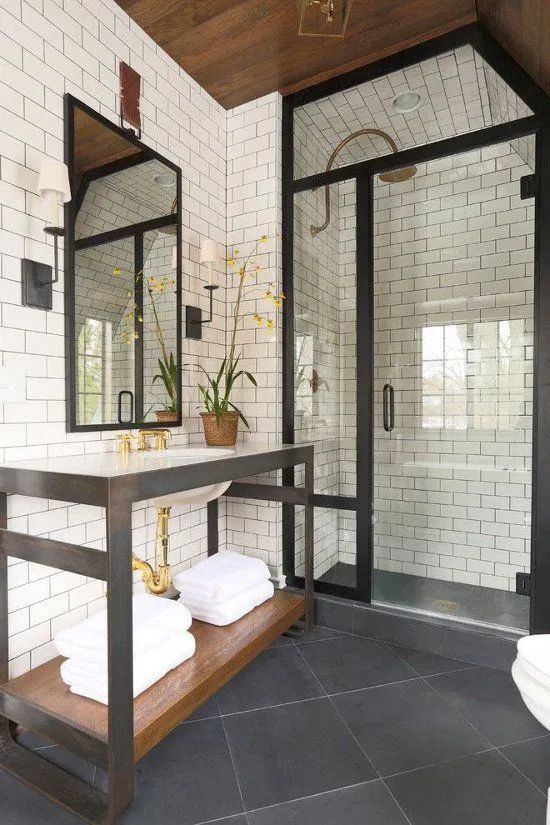 IPS flooring for a bathroom with black glass door profile and mirror
