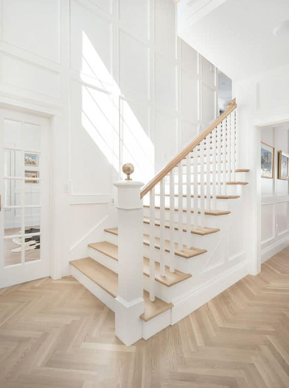 wood finish laminate floor for home entrance with white stairs