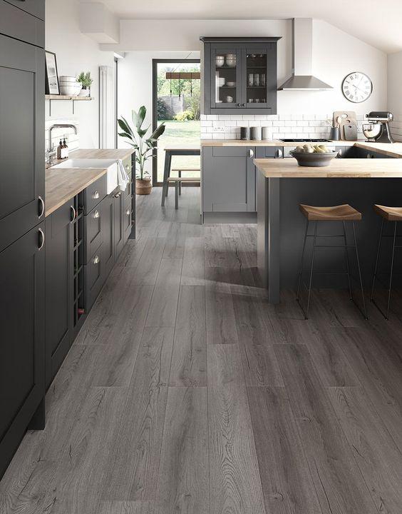 dark coloured laminate flooring for kitchen with black furniture