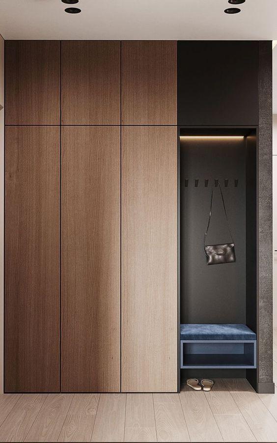 sleek wooden wardrobes with hanger rail in interior design with drawer system