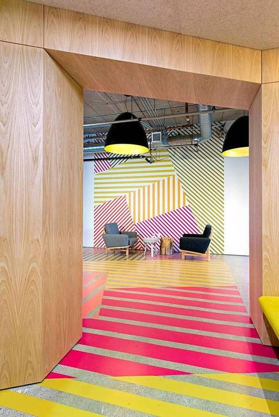 pink, green, and yellow flooring paint for a quirky office
