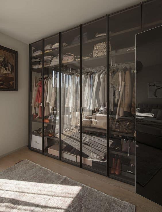 black framed glass wardrobes with interior design, lights, and drawer system