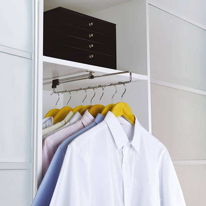 Pull-out rail for wardrobes